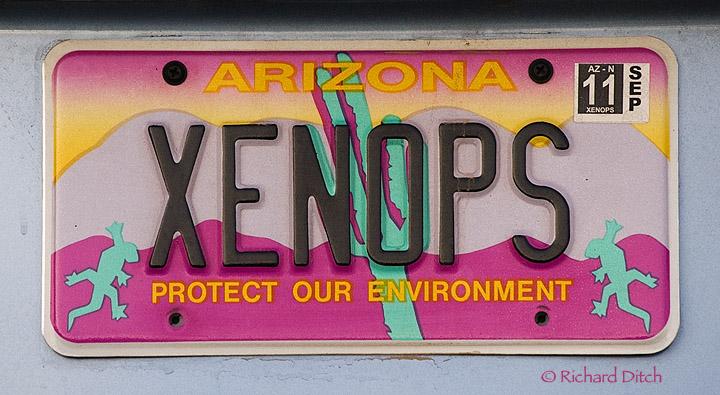 XENOPS vanity plate